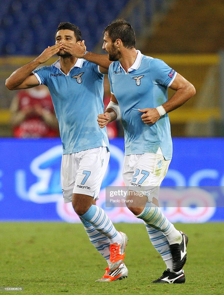 Honorato Ederson (L) with his team-mate <a gi-track='captionPersonalityLinkClicked' href=/galleries/search?phrase=Lorik+Cana&family=editorial&specificpeople=662499 ng-click='$event.stopPropagation()'>Lorik Cana</a> of S.S. Lazio celebrates after scoring the opening goal during the UEFA Europa League group J match between S.S. Lazio and NK Maribor at Stadio Olimpico on October 4, 2012 in Rome, Italy.