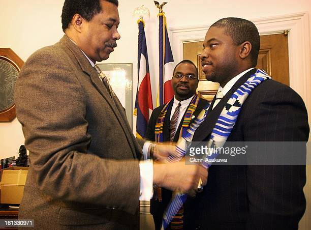 HONORDenver Mayor Wellington Webb places an African Kente cloth stole on state Rep Terrance Carroll right as state Sen Peter Groff watches during a...