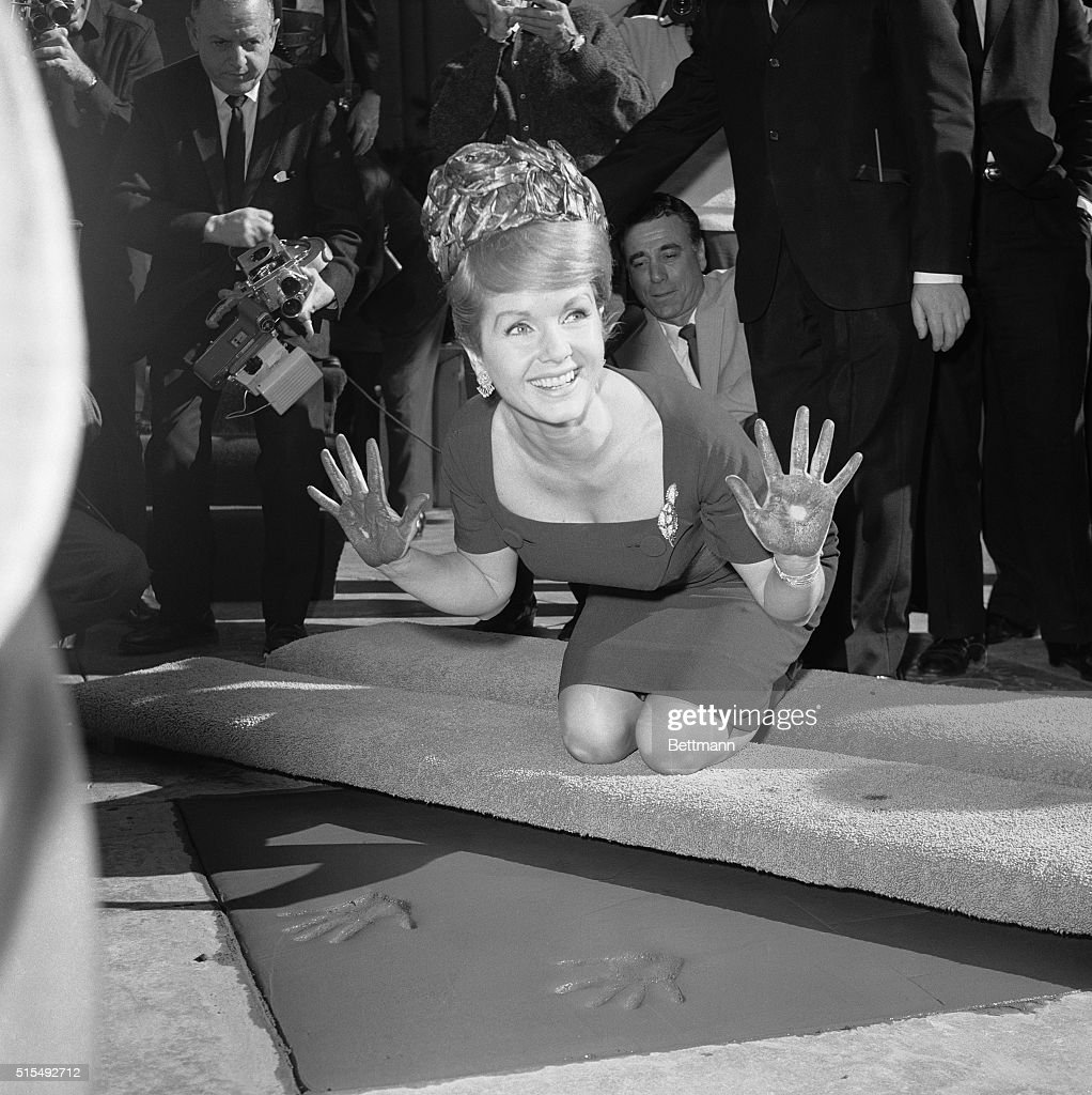 Honored at Grauman's Chinese Theater...Hollywood, California: Film star Debbie Reynolds smiles while displaying her cement-covered palms after pressing them into wet cement at Grauman's Chinese Theater here January 14th. She was the 148th film celebrity to be so honored at Grauman's. Her hand and footprints are now cast for posterity in the forecourt of the world-famous showcase.