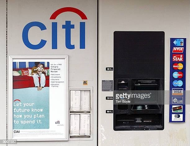 Honored credit and bank cards are displayed at a driveup ATM at a suburban Chicago Citibank branch bank February 23 2004 in Niles Illinois Citigroup...