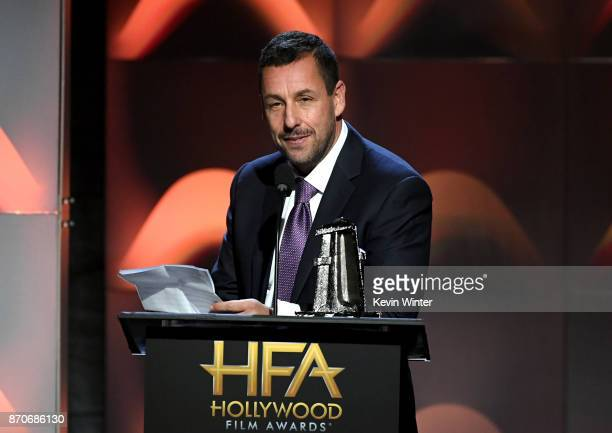 Honoree Adam Sandler accepts the Hollywood Comedy Award for 'The Meyerowitz Stories' onstage during the 21st Annual Hollywood Film Awards at The...
