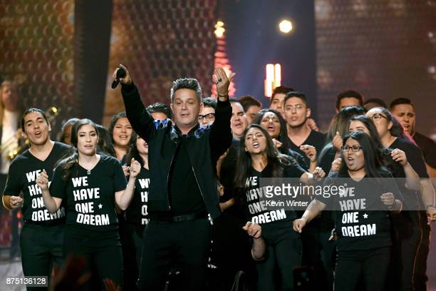 Honoree Alejandro Sanz performs with a group of 'DREAMers' onstage at the 18th Annual Latin Grammy Awards at MGM Grand Garden Arena on November 16...
