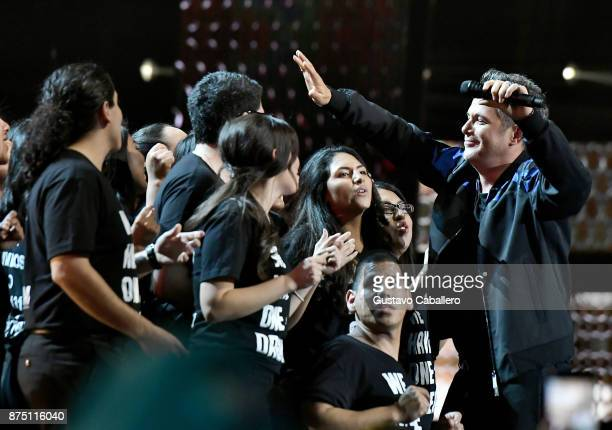 Honoree Alejandro Sanz performs with a group of 'DREAMers' onstage during The 18th Annual Latin Grammy Awards at MGM Grand Garden Arena on November...