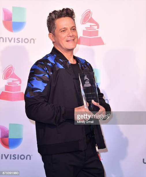 Honoree Alejandro Sanz poses with the award for Person of the Year in the press room during The 18th Annual Latin Grammy Awards at MGM Grand Garden...