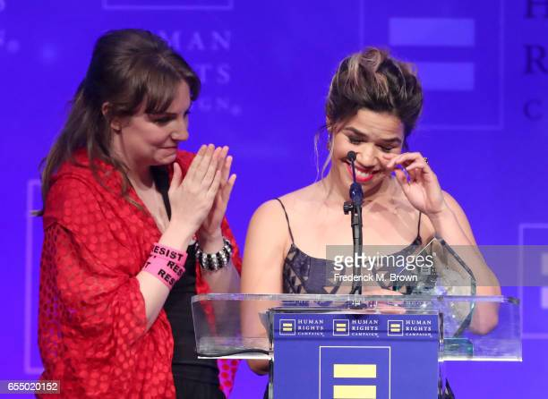 Honoree America Ferrera accepts the HRC Ally for Equality Award from actor Lena Dunham onstage at The Human Rights Campaign 2017 Los Angeles Gala...