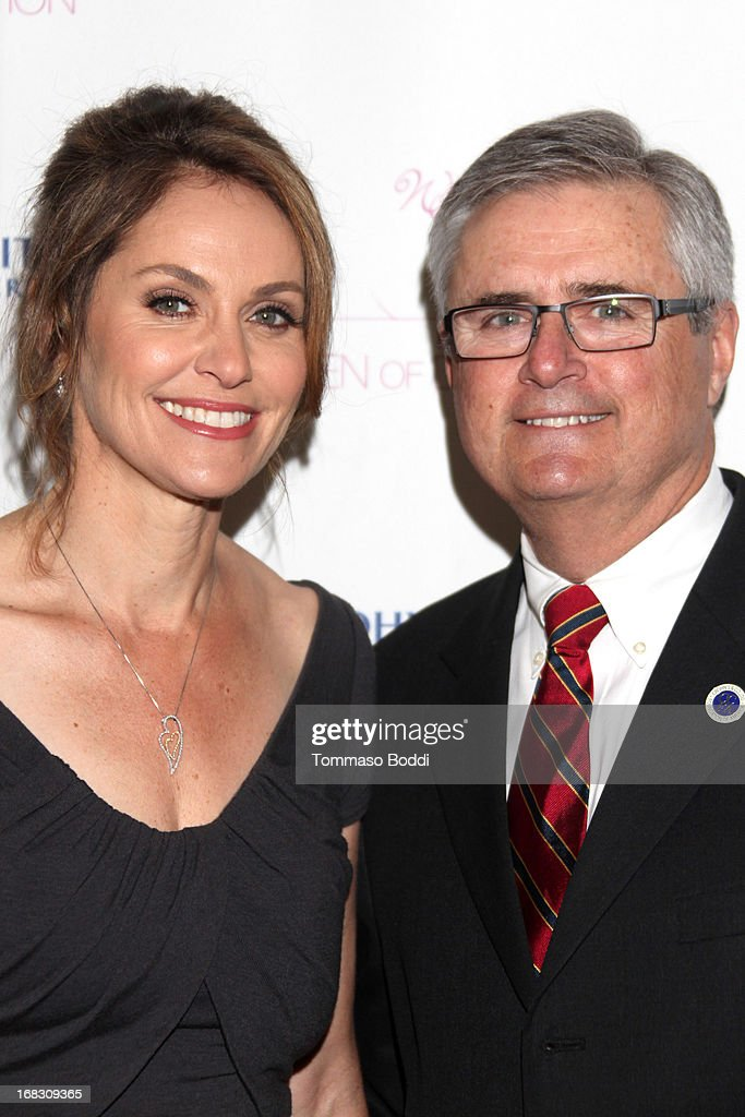 Honoree <a gi-track='captionPersonalityLinkClicked' href=/galleries/search?phrase=Amy+Brenneman&family=editorial&specificpeople=209217 ng-click='$event.stopPropagation()'>Amy Brenneman</a> (L) and CCFA President Richard Geswell attend the Women of Distinction luncheon held at Beverly Hills Hotel on May 8, 2013 in Beverly Hills, California.