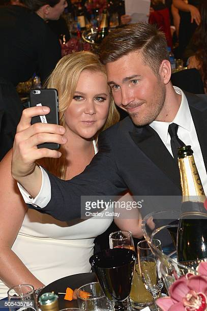Honoree Amy Schumer and designer Ben Hanisch pose for a selfie photo at the 21st Annual Critics' Choice Awards presented by FIJI Water at Barker...