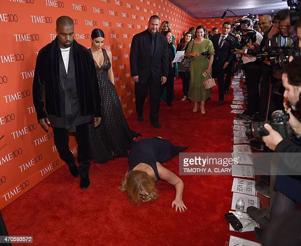 Honoree and comedian Amy Schumer pretends to trip and fall on the floor in front of honorees Kim Kardashian and Kanye West as they attend the Time...