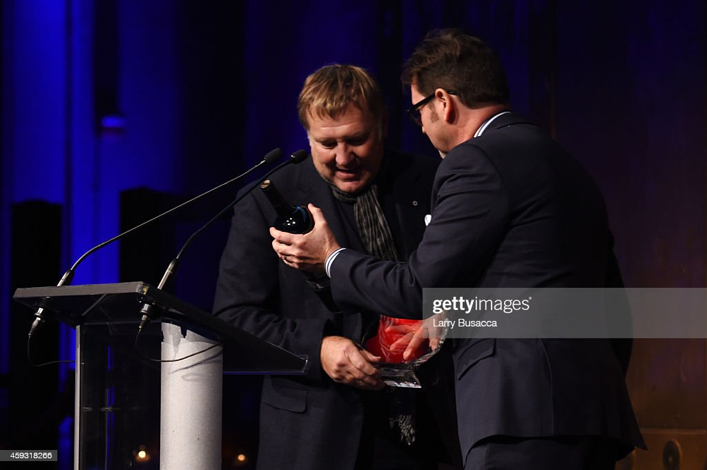 Honoree and guitarist Alex Lifeson of Rush and Marc Reiter appear onstage at the TJ Martell Foundation's 11th annual New York World Tour of Wine on...