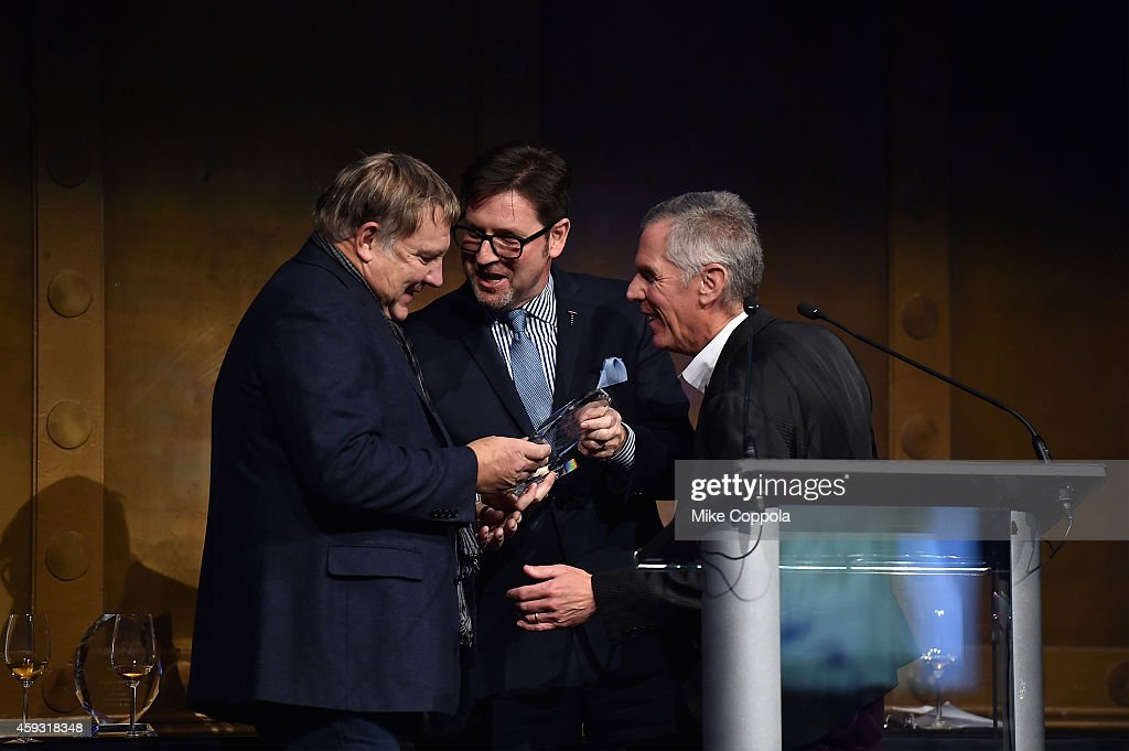Honoree and guitarist Alex Lifeson of Rush Marc Reiter and Bruce Gearhart appear onstage at the TJ Martell Foundation's 11th annual New York World...