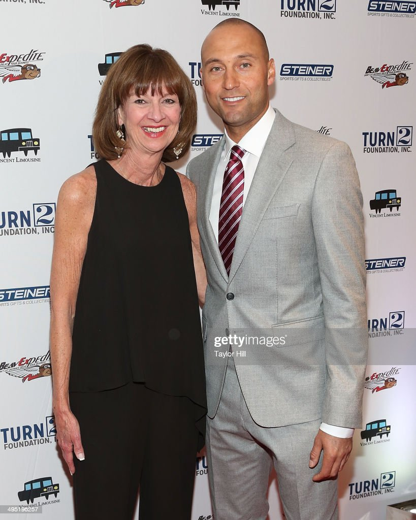 Honoree and New York Yankees SVP Marketing Deborah Tymon and New York Yankees shortstop <a gi-track='captionPersonalityLinkClicked' href=/galleries/search?phrase=Derek+Jeter&family=editorial&specificpeople=167125 ng-click='$event.stopPropagation()'>Derek Jeter</a> attend the <a gi-track='captionPersonalityLinkClicked' href=/galleries/search?phrase=Derek+Jeter&family=editorial&specificpeople=167125 ng-click='$event.stopPropagation()'>Derek Jeter</a> 18th Annual Turn 2 Foundation dinner at Sheraton New York Times Square on June 1, 2014 in New York City.
