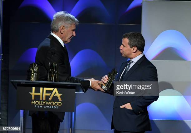 Honoree Andrew A Kosove accepts the Hollywood Producer Award for 'Blade Runner 2049' from actor Harrison Ford onstage at the 21st Annual Hollywood...
