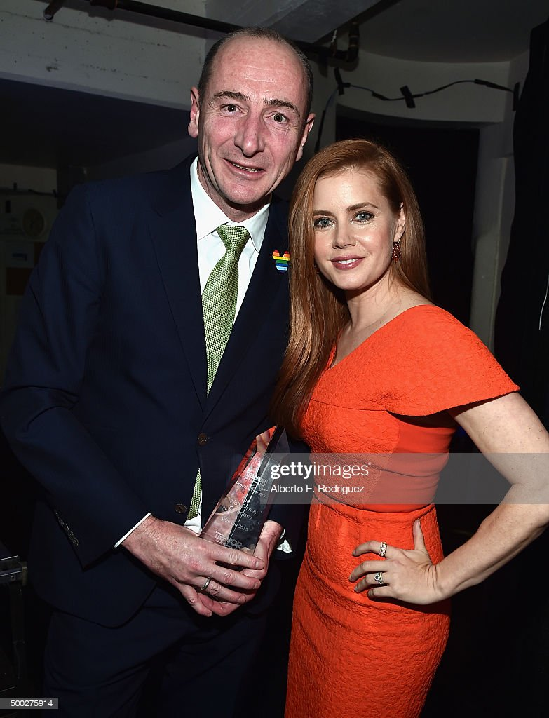Honoree Andy Bird (L) and actress Amy Adams pose with the Trevor 20/20 Visionary Award during TrevorLIVE LA 2015 at Hollywood Palladium on December 6, 2015 in Los Angeles, California.