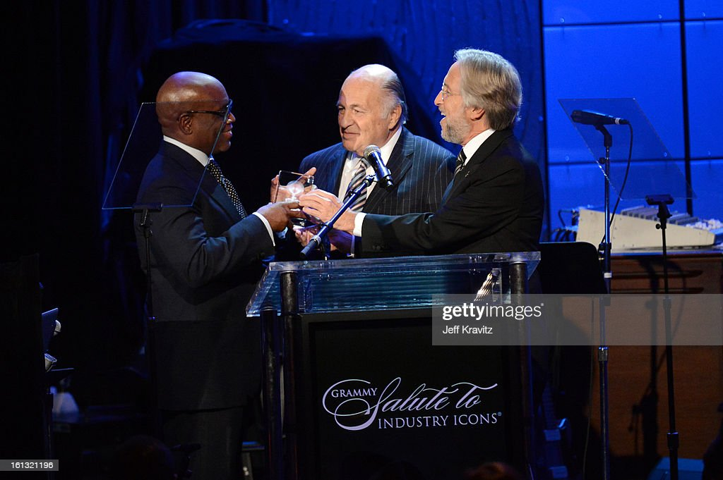 Honoree Antonio 'L.A.' Reid, Chairman/CEO of Sony Music Entertainment <a gi-track='captionPersonalityLinkClicked' href=/galleries/search?phrase=Doug+Morris&family=editorial&specificpeople=830291 ng-click='$event.stopPropagation()'>Doug Morris</a> and NARAS President <a gi-track='captionPersonalityLinkClicked' href=/galleries/search?phrase=Neil+Portnow&family=editorial&specificpeople=208909 ng-click='$event.stopPropagation()'>Neil Portnow</a> onstage at Clive Davis and The Recording Academy's 2013 GRAMMY Salute to Industry Icons Gala held at The Beverly Hilton Hotel on February 9, 2013 in Beverly Hills, California.
