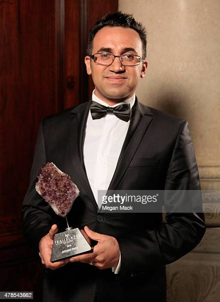 Honoree Arsham Parsi poses with award at Logo's 'Trailblazer Honors' 2015 at the Cathedral of St John the Divine on June 25 2015 in New York City