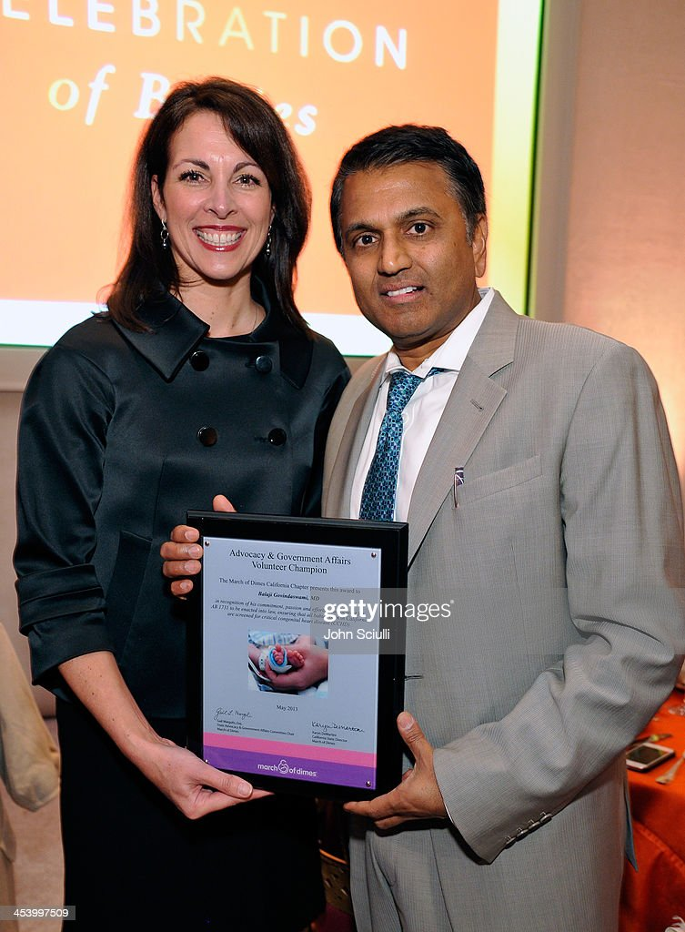 Honoree Balaji Govindaswami, M.D. (R) and Karyn DeMartini, State Director of March of Dimes, attend the March of Dimes Celebration of Babies Luncheon at Beverly Hills Hotel on December 6, 2013 in Beverly Hills, California.