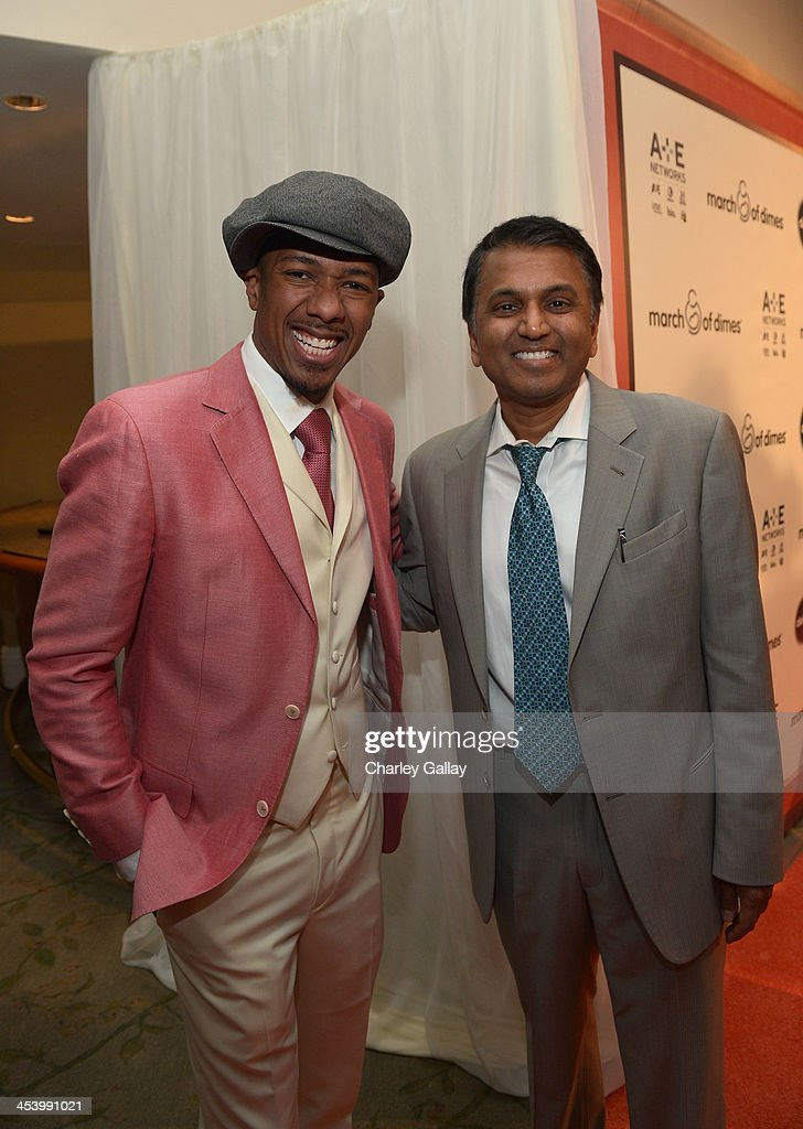 Honoree Balaji Govindaswami, M.D. (R) and Master of Ceremonies <a gi-track='captionPersonalityLinkClicked' href=/galleries/search?phrase=Nick+Cannon&family=editorial&specificpeople=202208 ng-click='$event.stopPropagation()'>Nick Cannon</a> attend the March of Dimes Celebration of Babies Luncheon at Beverly Hills Hotel on December 6, 2013 in Beverly Hills, California.
