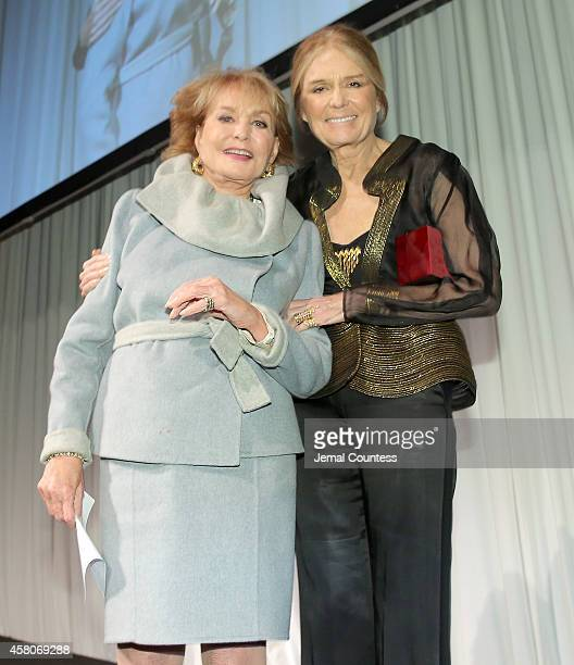Honoree Barbara Walters and The Women's Media Center cofounder Gloria Steinem pose onstage at the 2014 Women's Media Awards at Capitale on October 29...