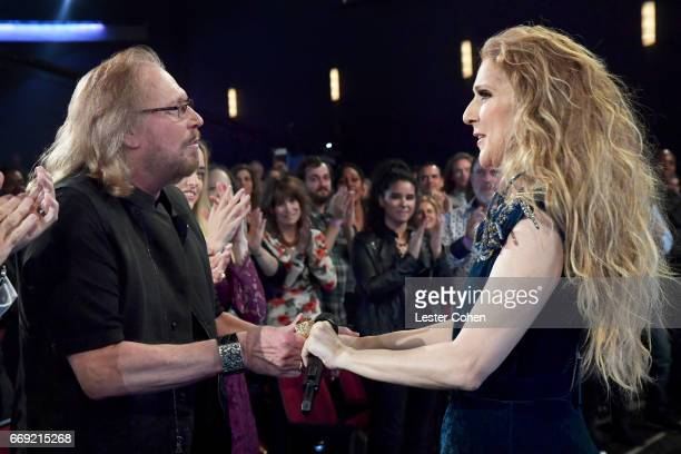 Honoree Barry Gibb and singer Celine Dion perform during 'Stayin' Alive A GRAMMY Salute To The Music Of The Bee Gees' on February 14 2017 in Los...