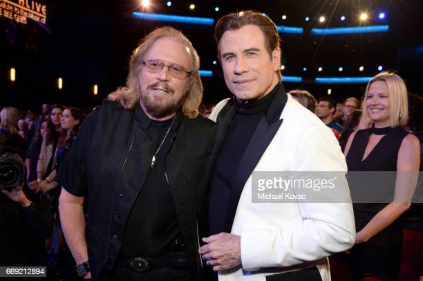 Honoree Barry Gibb of the Bee Gees and actor John Travolta attend 'Stayin' Alive A GRAMMY Salute To The Music Of The Bee Gees' on February 14 2017 in...