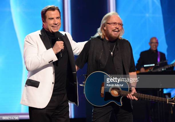Honoree Barry Gibb of the Bee Gees performs with actor John Travolta onstage during 'Stayin' Alive A GRAMMY Salute To The Music Of The Bee Gees' on...