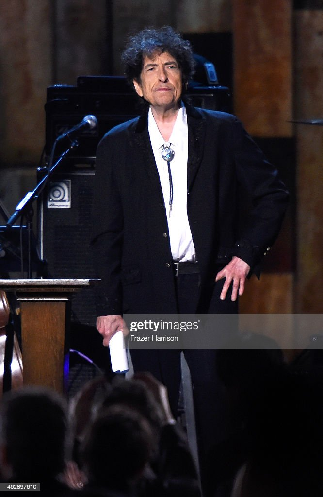 Honoree <a gi-track='captionPersonalityLinkClicked' href=/galleries/search?phrase=Bob+Dylan&family=editorial&specificpeople=203289 ng-click='$event.stopPropagation()'>Bob Dylan</a> appears onstage at the 25th anniversary MusiCares 2015 Person Of The Year Gala honoring <a gi-track='captionPersonalityLinkClicked' href=/galleries/search?phrase=Bob+Dylan&family=editorial&specificpeople=203289 ng-click='$event.stopPropagation()'>Bob Dylan</a> at the Los Angeles Convention Center on February 6, 2015 in Los Angeles, California. The annual benefit raises critical funds for MusiCares' Emergency Financial Assistance and Addiction Recovery programs.