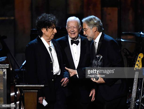 Honoree Bob Dylan former US President Jimmy Carter and National Academy of Recording Arts and Sciences President Neil Portnow appear onstage at the...