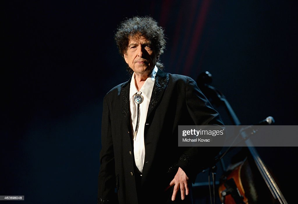 Honoree <a gi-track='captionPersonalityLinkClicked' href=/galleries/search?phrase=Bob+Dylan&family=editorial&specificpeople=203289 ng-click='$event.stopPropagation()'>Bob Dylan</a> speaks onstage at the 25th anniversary MusiCares 2015 Person Of The Year Gala honoring <a gi-track='captionPersonalityLinkClicked' href=/galleries/search?phrase=Bob+Dylan&family=editorial&specificpeople=203289 ng-click='$event.stopPropagation()'>Bob Dylan</a> at the Los Angeles Convention Center on February 6, 2015 in Los Angeles, California. The annual benefit raises critical funds for MusiCares' Emergency Financial Assistance and Addiction Recovery programs. For more information visit musicares.org.