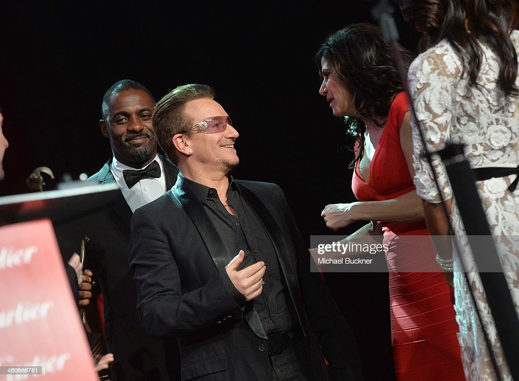 Honoree Bono accepts the Sonny Bono Visionary award from Mary Bono Mack onstage during the 25th annual Palm Springs International Film Festival awards gala at Palm Springs Convention Center on January 4, 2014 in Palm Springs, California.