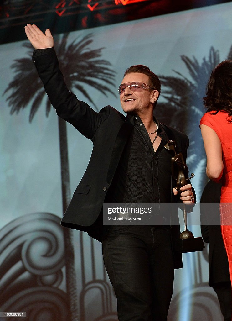 Honoree Bono accepts the Sonny Bono Visionary award onstage during the 25th annual Palm Springs International Film Festival awards gala at Palm Springs Convention Center on January 4, 2014 in Palm Springs, California.