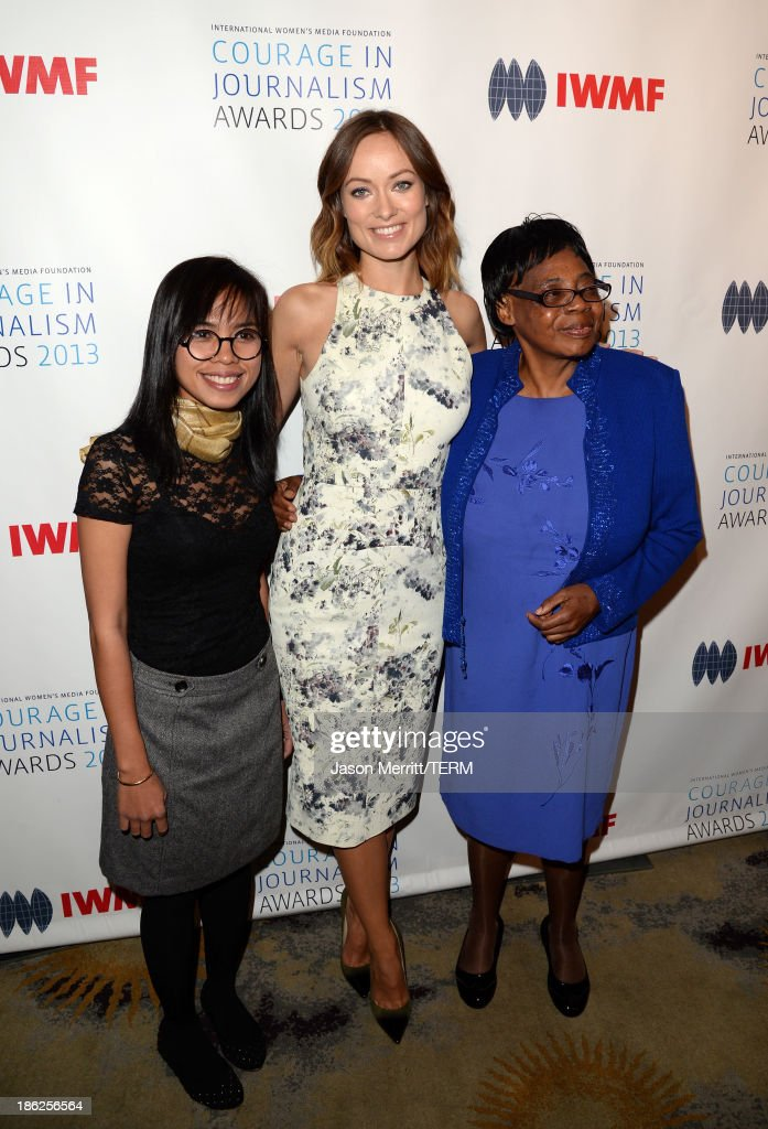 Honoree Bopha Phorn, actress <a gi-track='captionPersonalityLinkClicked' href=/galleries/search?phrase=Olivia+Wilde&family=editorial&specificpeople=235399 ng-click='$event.stopPropagation()'>Olivia Wilde</a> and Lifetime Achievement Award winner Edna Machirori attend the International Women's Media Foundation's 2013 Courage in Journalism Awards at the Beverly Hills Hotel on October 29, 2013 in Beverly Hills, California.