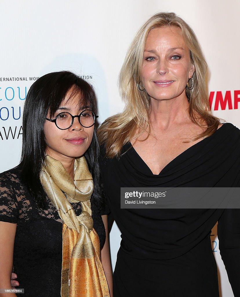 Honoree Bopha Phorn (L) and actress <a gi-track='captionPersonalityLinkClicked' href=/galleries/search?phrase=Bo+Derek&family=editorial&specificpeople=204653 ng-click='$event.stopPropagation()'>Bo Derek</a> attend the IWMF Courage in Journalism Awards 2013 at the Beverly Hills Hotel on October 29, 2013 in Beverly Hills, California.