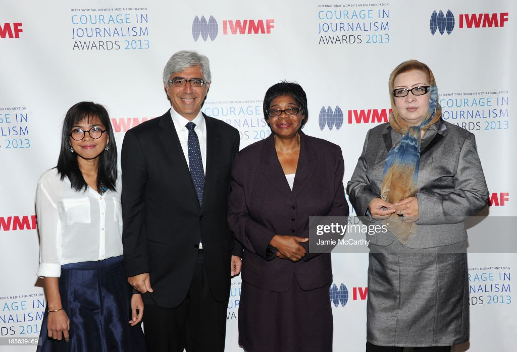 Honoree Bopha Phorn, Board of Chair of IWMF Ted Boutrous, Honoree Edna Machirori and Honoree Najiba Ayubi attend the International Women's Media Foundation's 2013 Courage In Journalism And Lifetime Achievement Awards at Cipriani 42nd Street on October 23, 2013 in New York City.