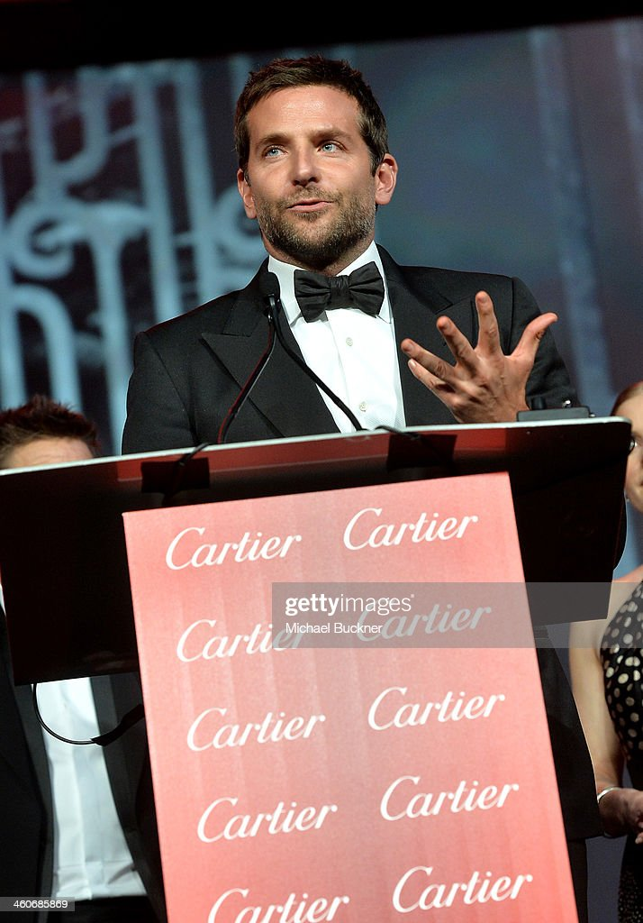 Honoree <a gi-track='captionPersonalityLinkClicked' href=/galleries/search?phrase=Bradley+Cooper&family=editorial&specificpeople=680224 ng-click='$event.stopPropagation()'>Bradley Cooper</a> accepts the Ensemble Performance award for 'American Hustle' onstage during the 25th annual Palm Springs International Film Festival awards gala at Palm Springs Convention Center on January 4, 2014 in Palm Springs, California.