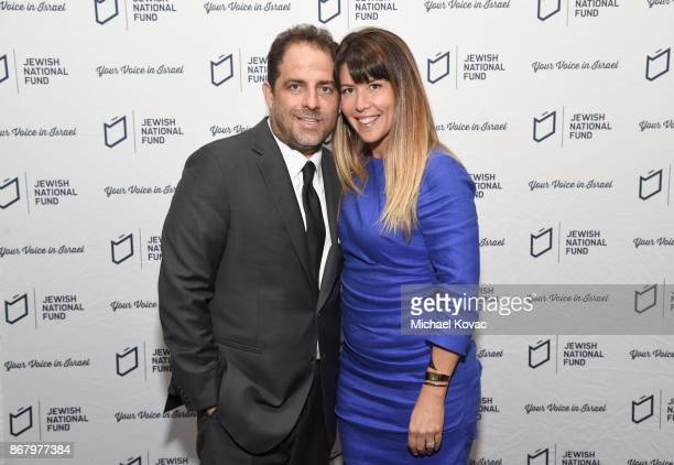 Honoree Brett Ratner and Patty Jenkins attend the Jewish National Fund Los Angeles Tree Of Life Dinner at Loews Hollywood Hotel on October 29 2017 in...