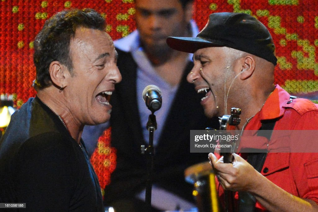 Honoree <a gi-track='captionPersonalityLinkClicked' href=/galleries/search?phrase=Bruce+Springsteen&family=editorial&specificpeople=123832 ng-click='$event.stopPropagation()'>Bruce Springsteen</a> (L) and guitarist <a gi-track='captionPersonalityLinkClicked' href=/galleries/search?phrase=Tom+Morello&family=editorial&specificpeople=2133151 ng-click='$event.stopPropagation()'>Tom Morello</a> perform onstage at The 2013 MusiCares Person Of The Year Gala Honoring <a gi-track='captionPersonalityLinkClicked' href=/galleries/search?phrase=Bruce+Springsteen&family=editorial&specificpeople=123832 ng-click='$event.stopPropagation()'>Bruce Springsteen</a> at Los Angeles Convention Center on February 8, 2013 in Los Angeles, California.