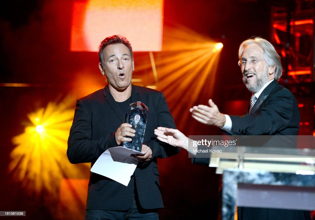 Honoree Bruce Springsteen and NARAS President Neil Portnow speak onstage during the MusiCares Person Of The Year Honoring Bruce Springsteen at the...