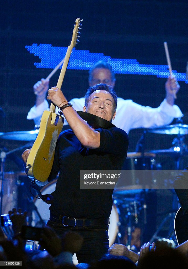 Honoree <a gi-track='captionPersonalityLinkClicked' href=/galleries/search?phrase=Bruce+Springsteen&family=editorial&specificpeople=123832 ng-click='$event.stopPropagation()'>Bruce Springsteen</a> performs onstage at The 2013 MusiCares Person Of The Year Gala Honoring <a gi-track='captionPersonalityLinkClicked' href=/galleries/search?phrase=Bruce+Springsteen&family=editorial&specificpeople=123832 ng-click='$event.stopPropagation()'>Bruce Springsteen</a> at Los Angeles Convention Center on February 8, 2013 in Los Angeles, California.