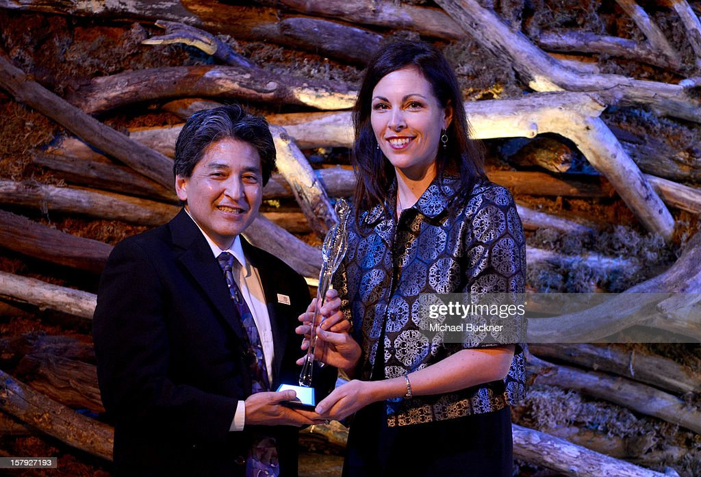 Honoree Bryan Oshiro M.D. accepts the Elaine Whitelaw Volunteer Service Award from Karyn DeMartini, State Director of March of Dimes California Chapter onstage at the 7th Annual March of Dimes Celebration of Babies, a Hollywood Luncheon, at the Beverly Hills Hotel on December 7, 2012 in Beverly Hills, California.
