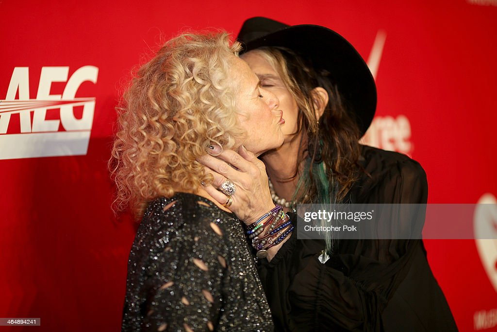 Honoree Carole King (L) and Aerosmith singer Steven Tyler attend 2014 MusiCares Person Of The Year Honoring Carole King at Los Angeles Convention Center on January 24, 2014 in Los Angeles, California.