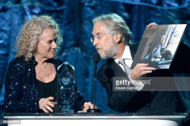 Honoree Carole King and CEO/President of the National Academy of Recording Arts Sciences Neil Portnow perform onstage at The 2014 MusiCares Person Of...