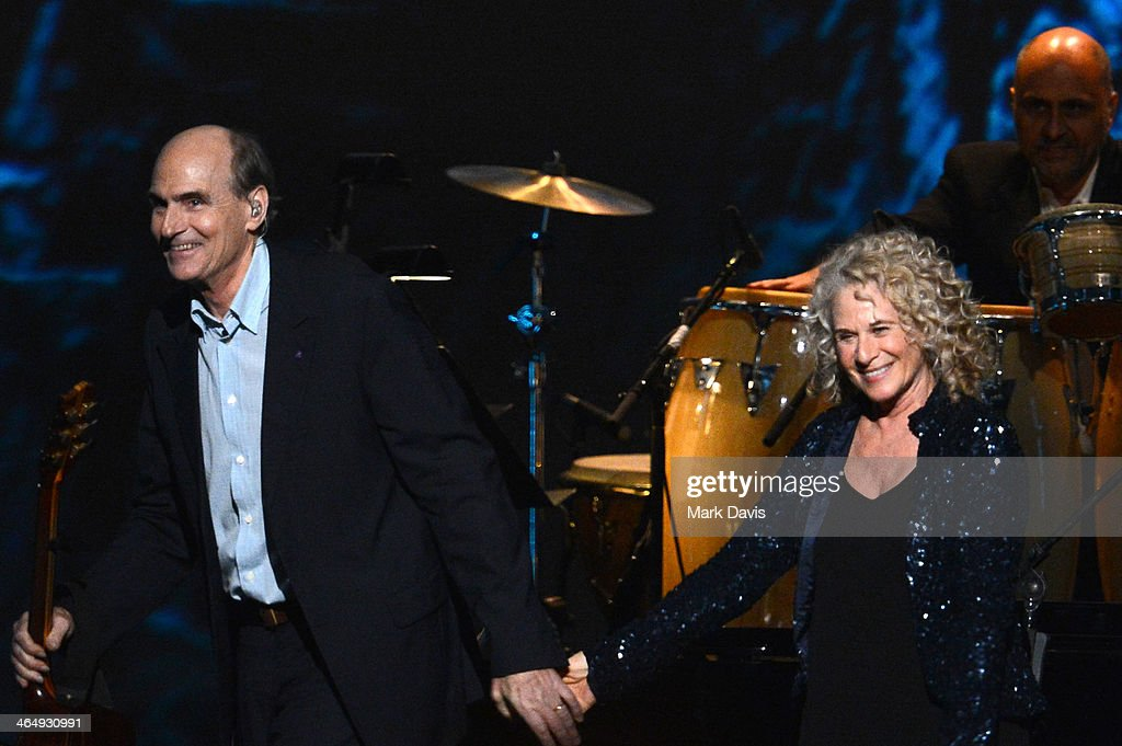 Honoree <a gi-track='captionPersonalityLinkClicked' href=/galleries/search?phrase=Carole+King+-+Musician&family=editorial&specificpeople=211440 ng-click='$event.stopPropagation()'>Carole King</a> (R) and musician James Taylor perform onstage at 2014 MusiCares Person Of The Year Honoring <a gi-track='captionPersonalityLinkClicked' href=/galleries/search?phrase=Carole+King+-+Musician&family=editorial&specificpeople=211440 ng-click='$event.stopPropagation()'>Carole King</a> at Los Angeles Convention Center on January 24, 2014 in Los Angeles, California.