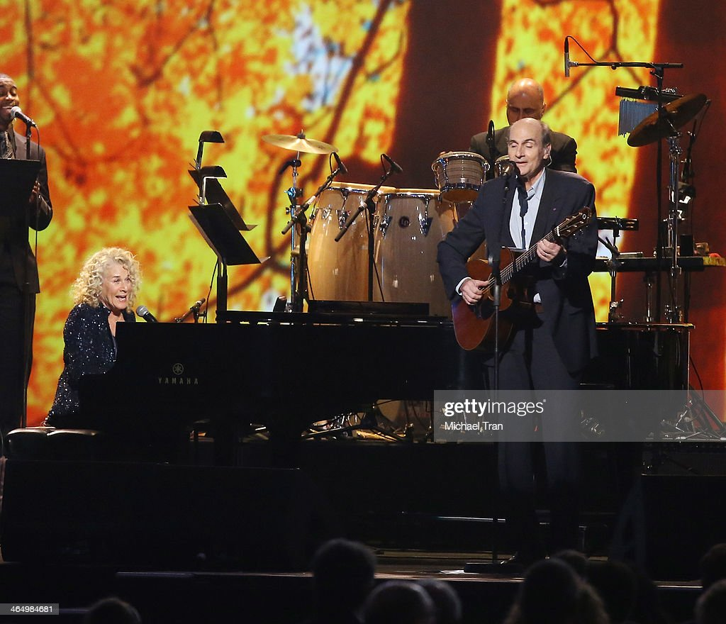 Honoree <a gi-track='captionPersonalityLinkClicked' href=/galleries/search?phrase=Carole+King+-+Musician&family=editorial&specificpeople=211440 ng-click='$event.stopPropagation()'>Carole King</a> (L) and musician James Taylor perform onstage during the 2014 MusiCares Person of the Year honoring <a gi-track='captionPersonalityLinkClicked' href=/galleries/search?phrase=Carole+King+-+Musician&family=editorial&specificpeople=211440 ng-click='$event.stopPropagation()'>Carole King</a> held at Los Angeles Convention Center on January 24, 2014 in Los Angeles, California.