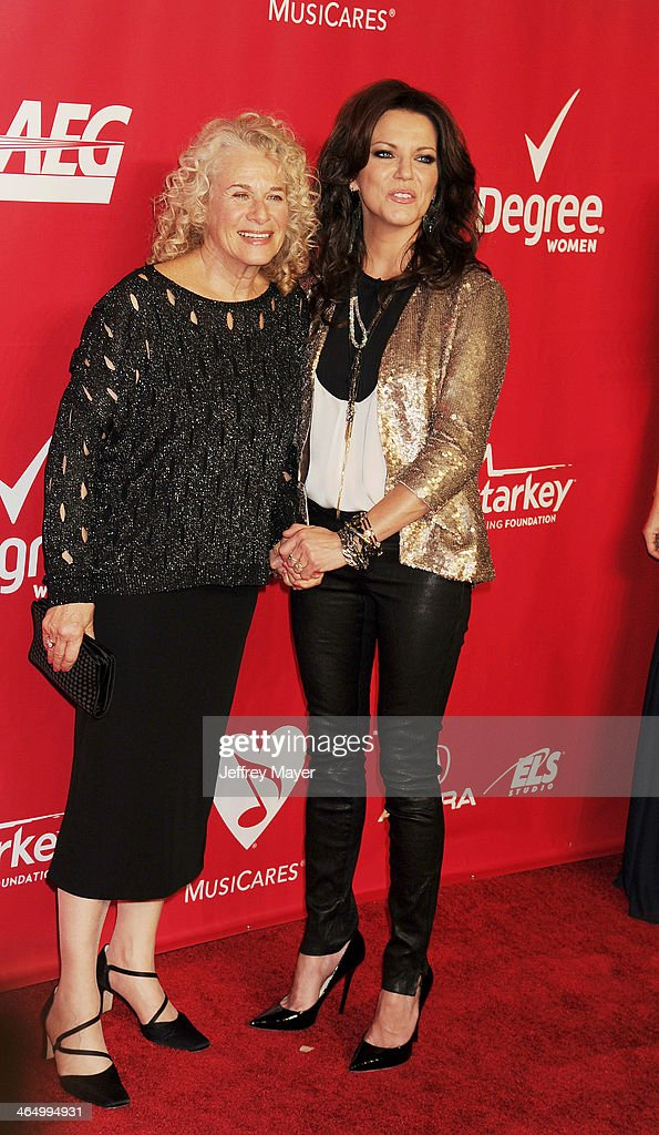 Honoree <a gi-track='captionPersonalityLinkClicked' href=/galleries/search?phrase=Carole+King+-+Musician&family=editorial&specificpeople=211440 ng-click='$event.stopPropagation()'>Carole King</a> (L) and singer <a gi-track='captionPersonalityLinkClicked' href=/galleries/search?phrase=Martina+McBride&family=editorial&specificpeople=204772 ng-click='$event.stopPropagation()'>Martina McBride</a> attend 2014 MusiCares Person Of The Year Honoring <a gi-track='captionPersonalityLinkClicked' href=/galleries/search?phrase=Carole+King+-+Musician&family=editorial&specificpeople=211440 ng-click='$event.stopPropagation()'>Carole King</a> at Los Angeles Convention Center on January 24, 2014 in Los Angeles, California.