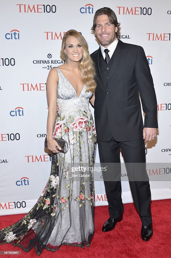 Honoree <a gi-track='captionPersonalityLinkClicked' href=/galleries/search?phrase=Carrie+Underwood&family=editorial&specificpeople=204483 ng-click='$event.stopPropagation()'>Carrie Underwood</a> (L) and husband <a gi-track='captionPersonalityLinkClicked' href=/galleries/search?phrase=Mike+Fisher&family=editorial&specificpeople=204732 ng-click='$event.stopPropagation()'>Mike Fisher</a> attend the TIME 100 Gala, TIME's 100 most influential people in the world, at Jazz at Lincoln Center on April 29, 2014 in New York City.