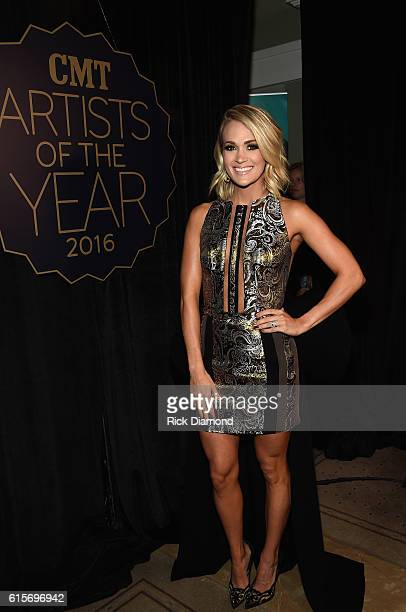 Honoree Carrie Underwood arrives on the red carpet at CMT Artists of the Year 2016 on October 19 2016 in Nashville Tennessee