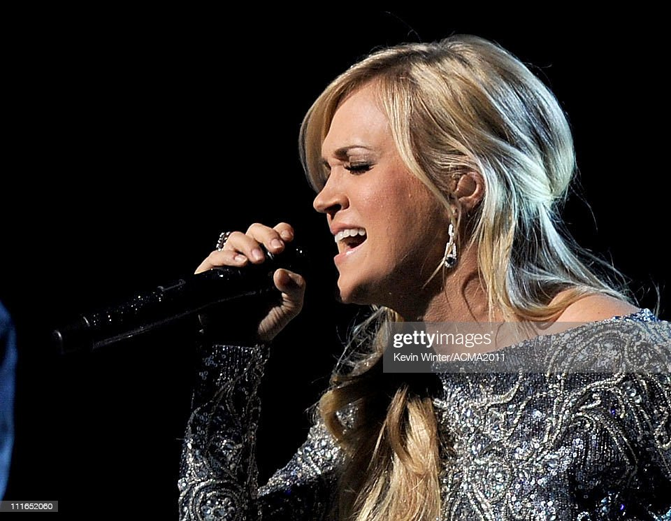 Honoree <a gi-track='captionPersonalityLinkClicked' href=/galleries/search?phrase=Carrie+Underwood&family=editorial&specificpeople=204483 ng-click='$event.stopPropagation()'>Carrie Underwood</a> performs onstage during ACM Presents: Girls' Night Out: Superstar Women of Country concert held at the MGM Grand Garden Arena on April 4, 2011 in Las Vegas, Nevada.