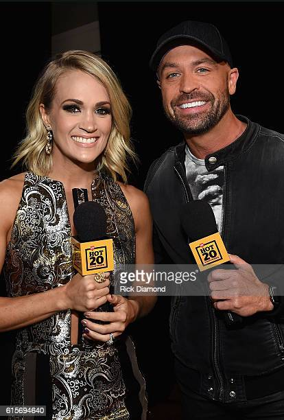 Honoree Carrie Underwoodi and CMT Radio's Cody Allen arrive on the red carpet at CMT Artists of the Year 2016 on October 19 2016 in Nashville...