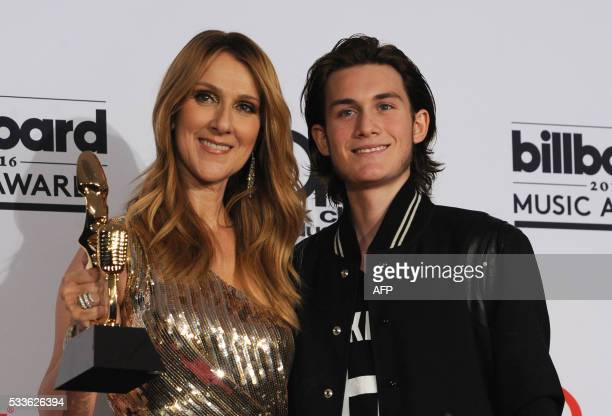 Honoree Celine Dion recipient of the Icon Award and ReneCharles Angelil pose in the Photo Room during the 2016 Billboard Music Awards at the TMobile...