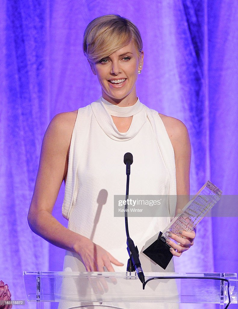 Honoree <a gi-track='captionPersonalityLinkClicked' href=/galleries/search?phrase=Charlize+Theron&family=editorial&specificpeople=171250 ng-click='$event.stopPropagation()'>Charlize Theron</a> accepts an award onstage during Variety's 5th Annual Power of Women event presented by Lifetime at the Beverly Wilshire Four Seasons Hotel on October 4, 2013 in Beverly Hills, California.